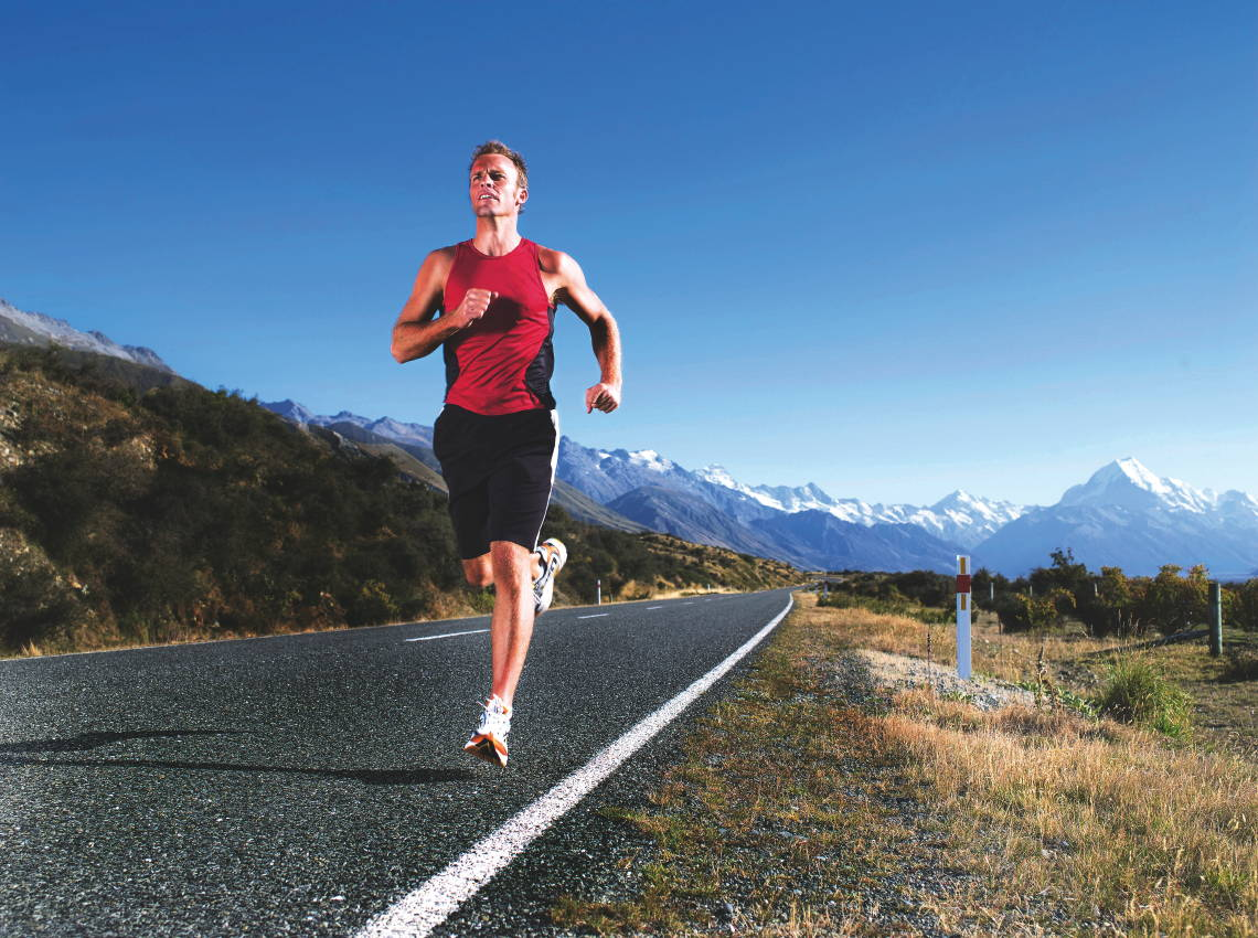 Man Jogging on Open Road --- Image by © Dave & Les Jacobs/Photoconcepts/Corbis
